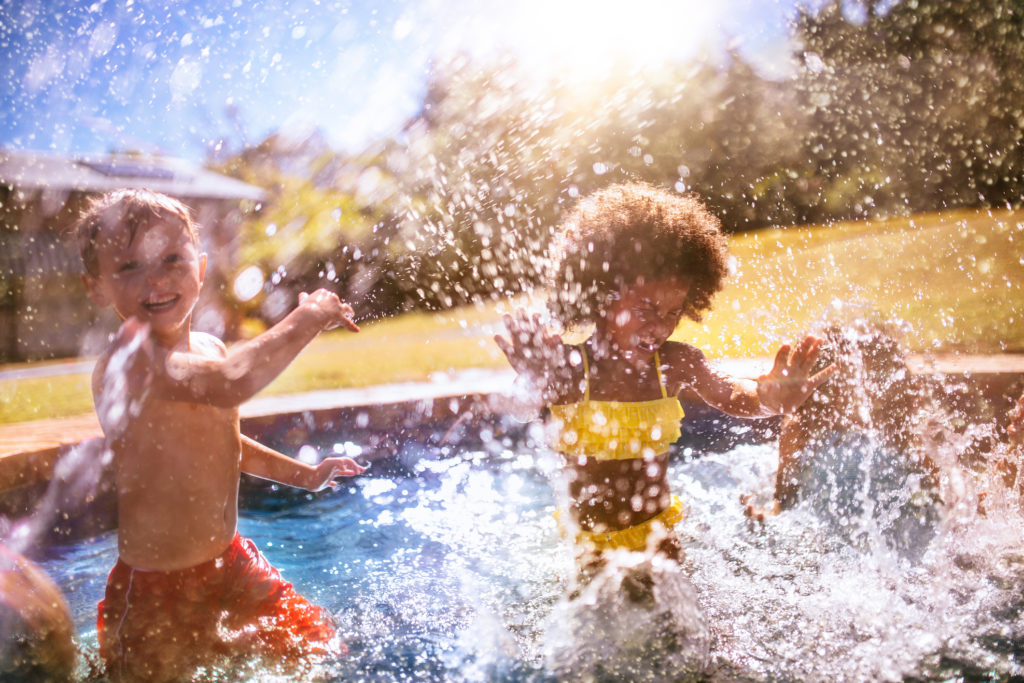 two children playing in New Carrollton apartment pool