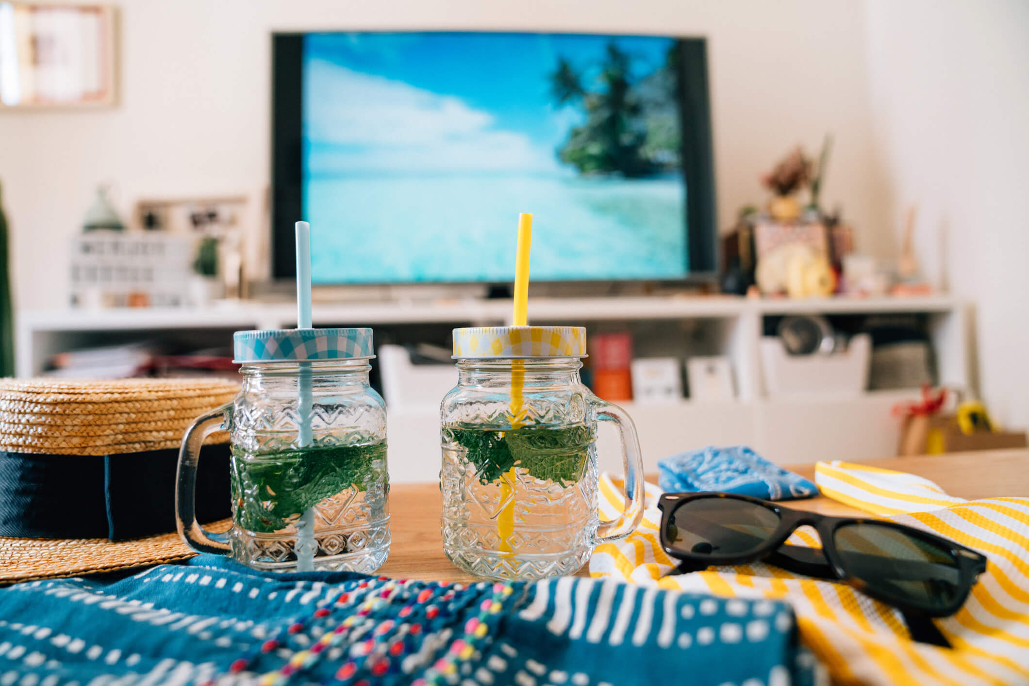 mason jars in front of TV